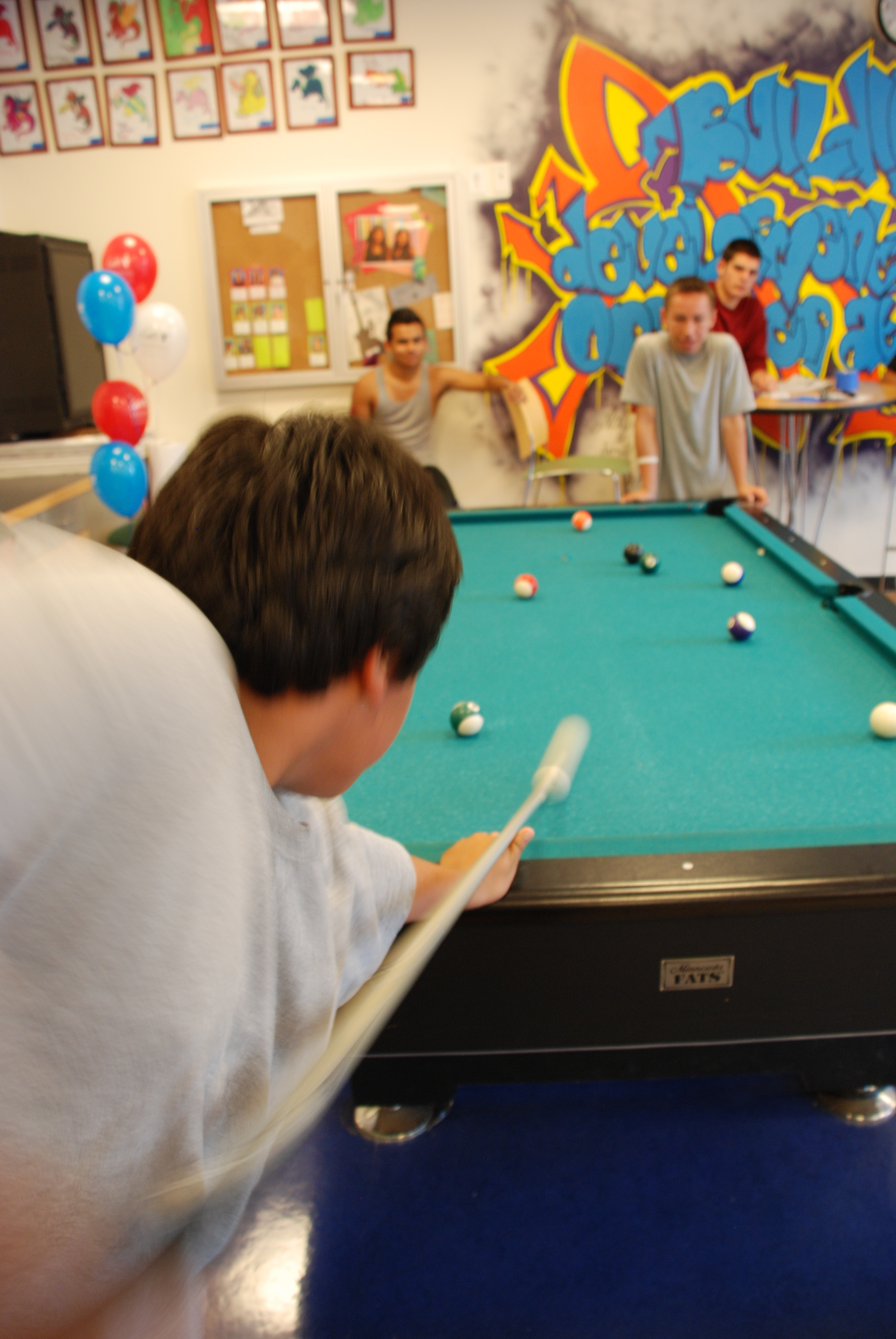 Teens Enjoying Pool Game