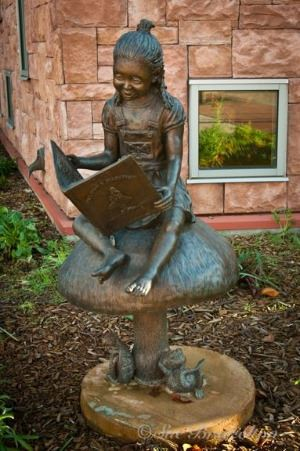 Once Upon a Mushroom Bronze Sculpture at the Library by Evelyn Davis