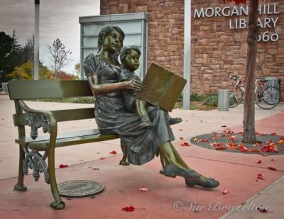 Story Time Bronze Sculpture Bench in Front of Library
