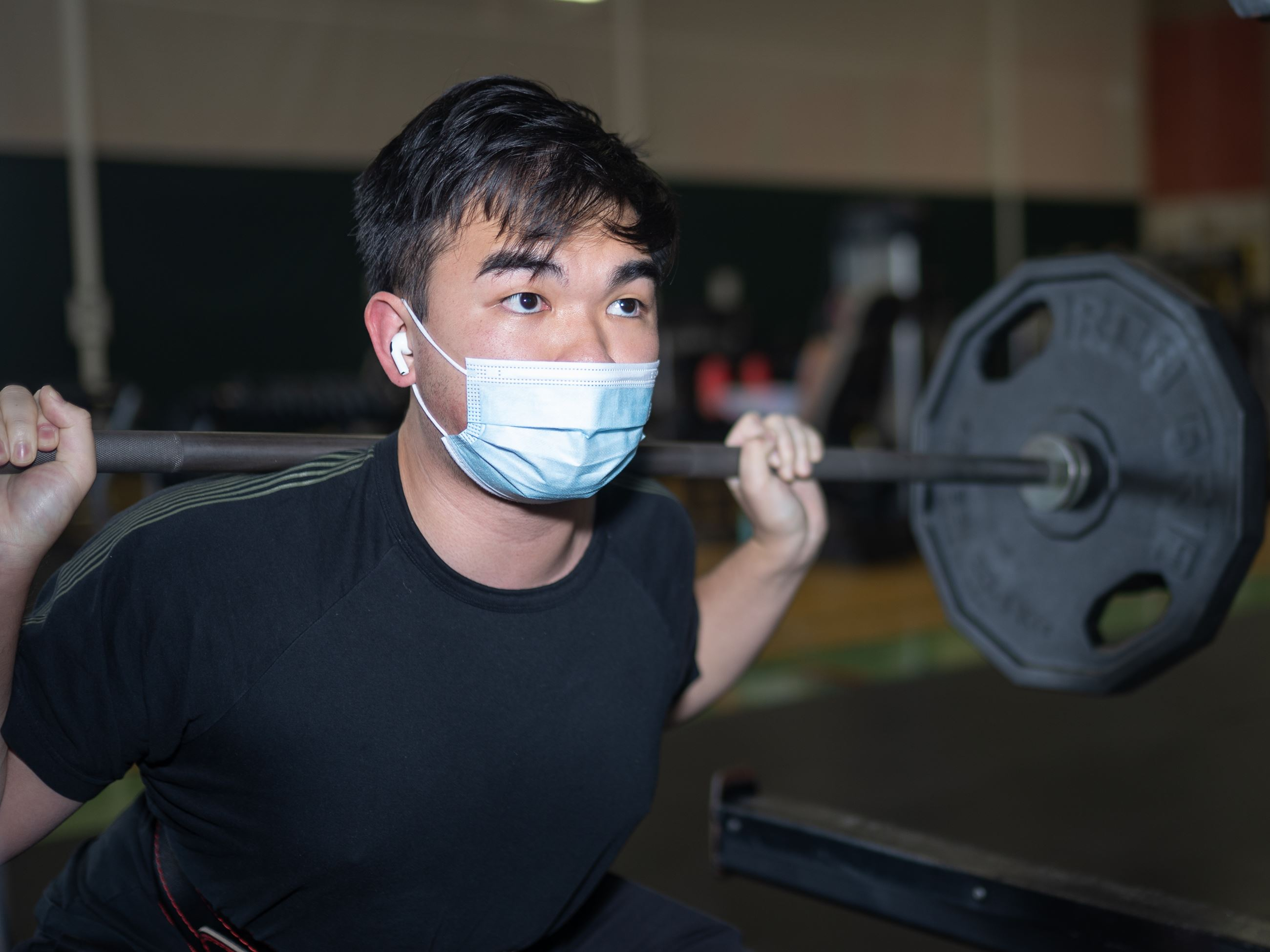 Man wearing a mask working out at the CRC